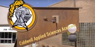 The school logo on a sculpture