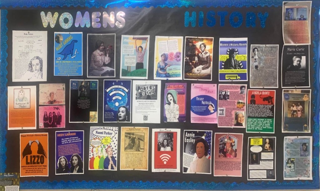 a display of all the posters printed out and hung on a bulletin board.